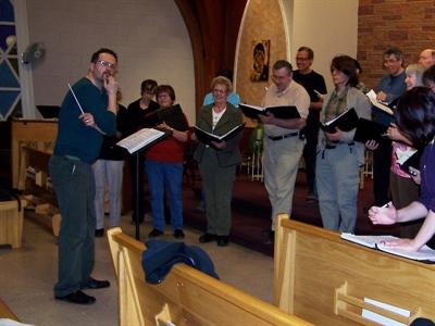 Le Chœur des Plaines en répétition, sous la direction musicale de Michael Harris